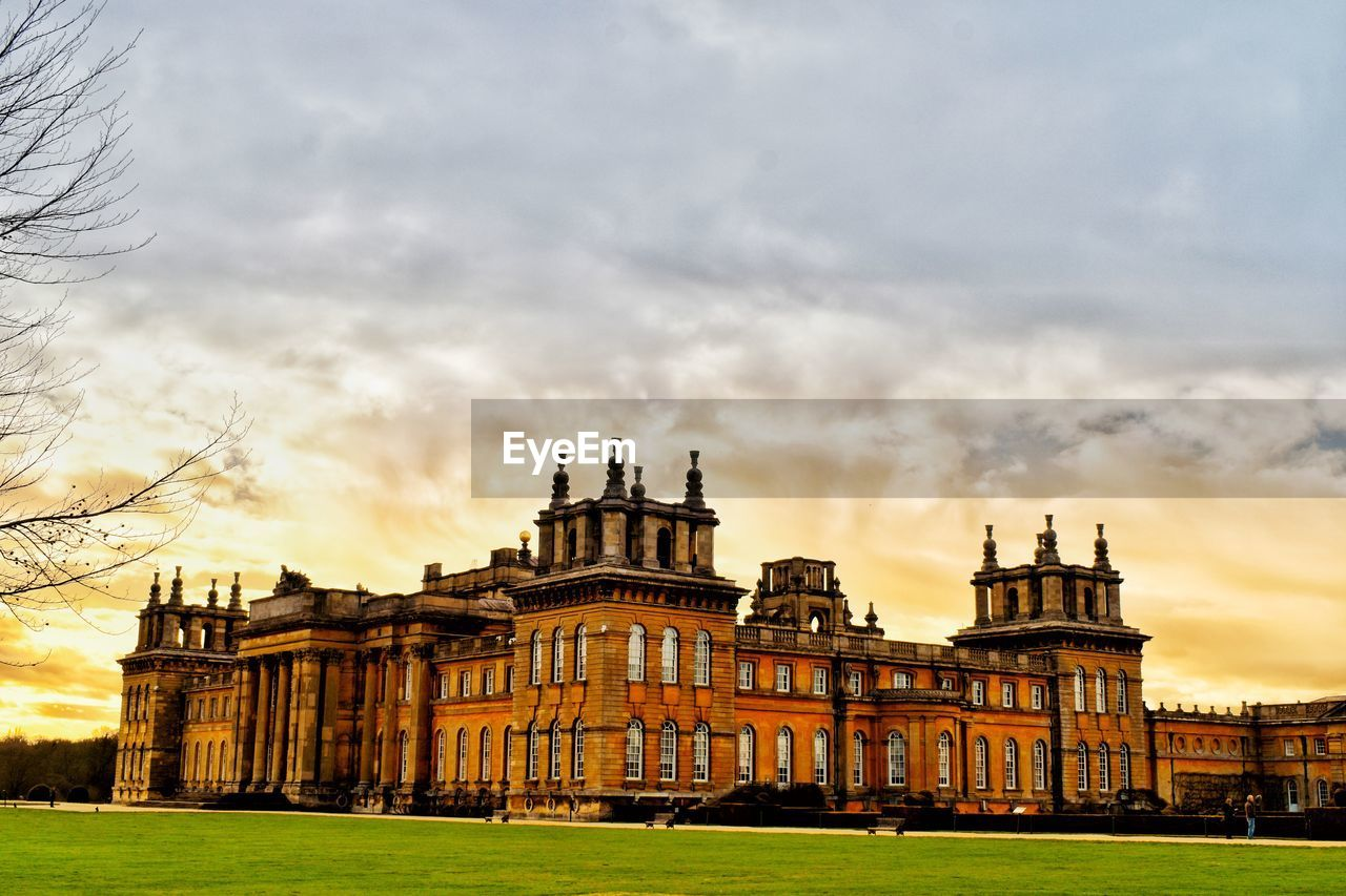 architecture, built structure, building exterior, sky, cloud - sky, travel destinations, nature, building, city, the past, history, sunset, travel, tourism, grass, no people, outdoors, mansion, palace, government, spire
