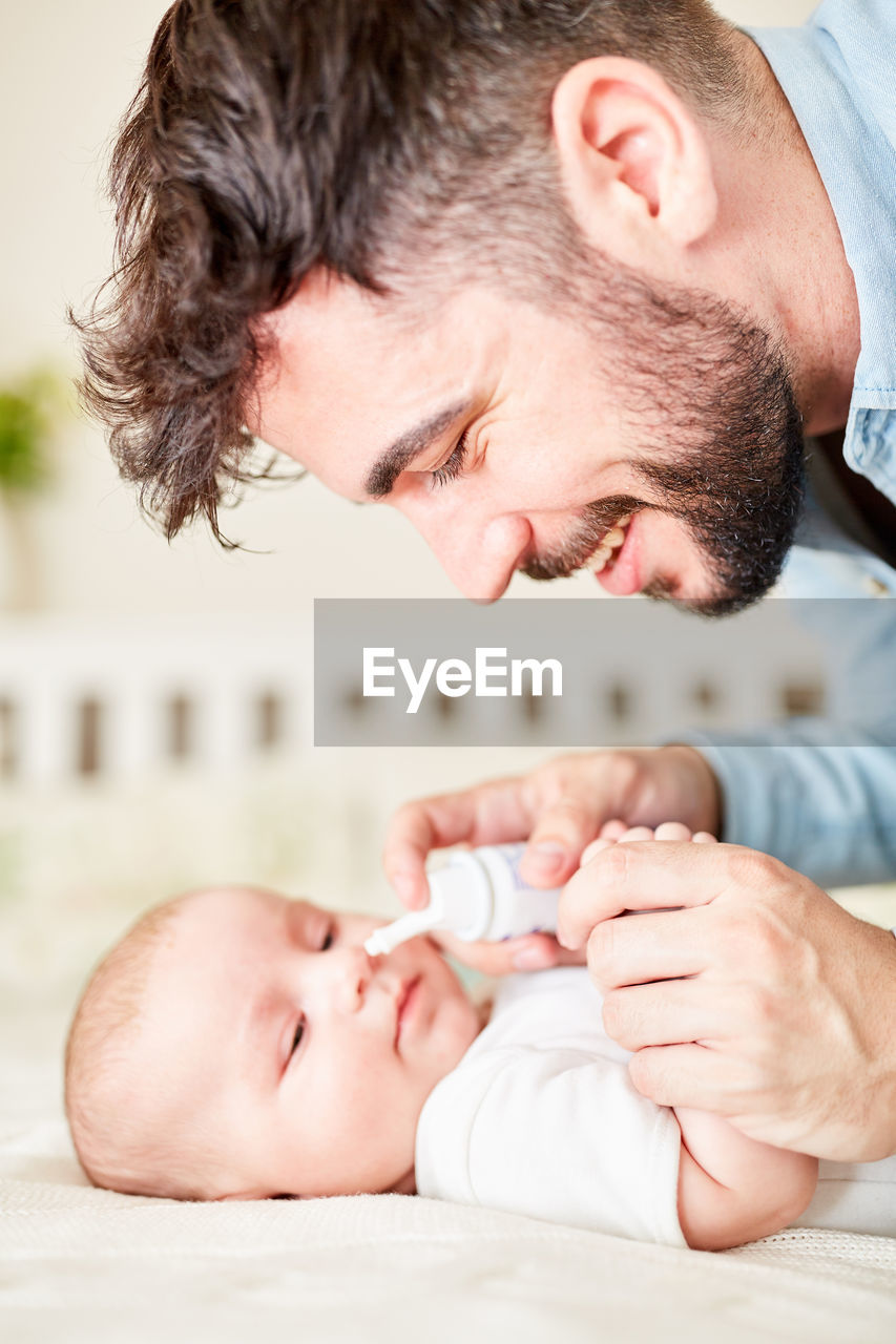 baby, young, two people, babyhood, real people, child, men, newborn, indoors, males, childhood, focus on foreground, love, adult, beginnings, togetherness, people, innocence, care, positive emotion