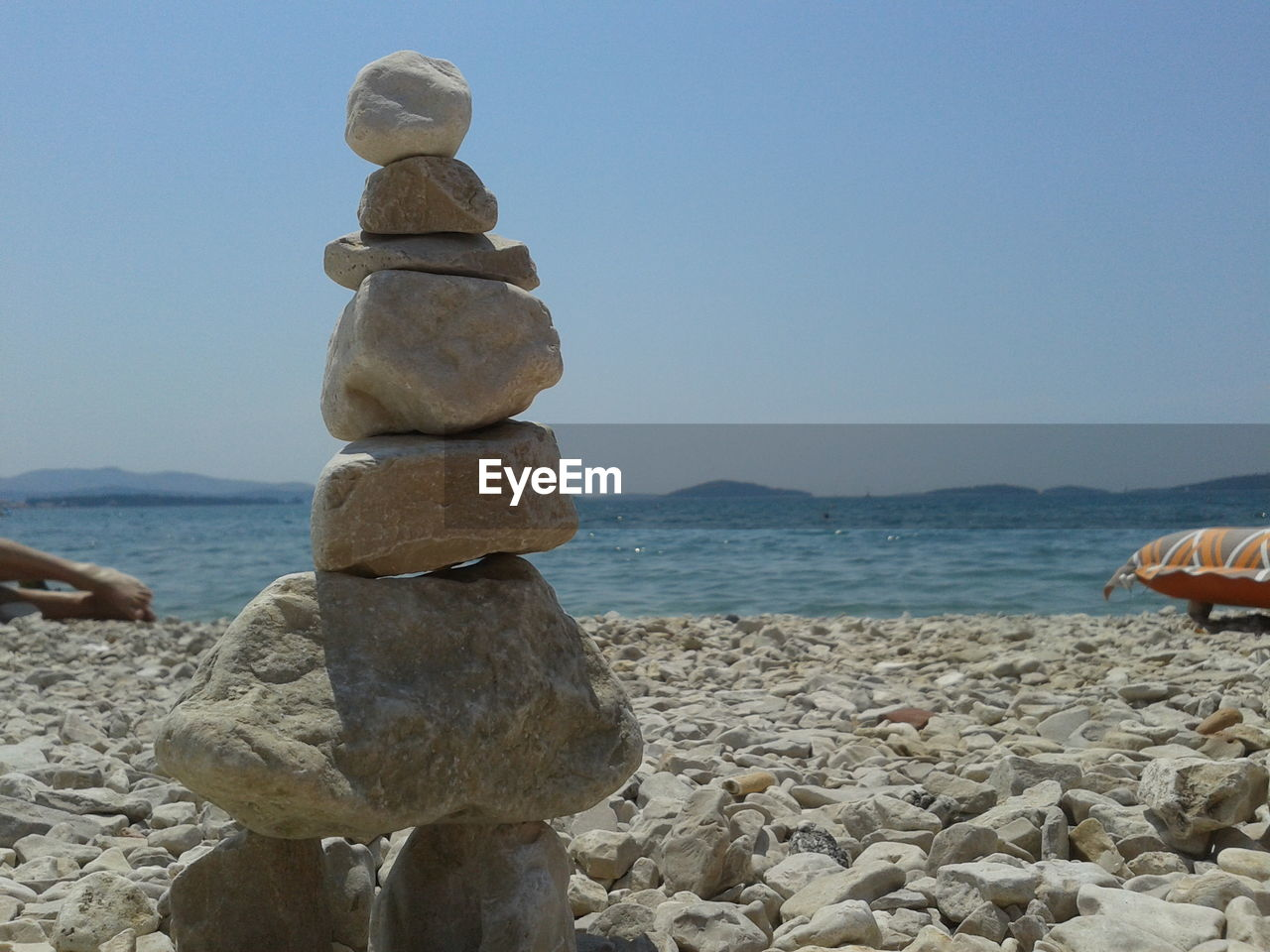 Close-Up Of Stone Stack On Beach