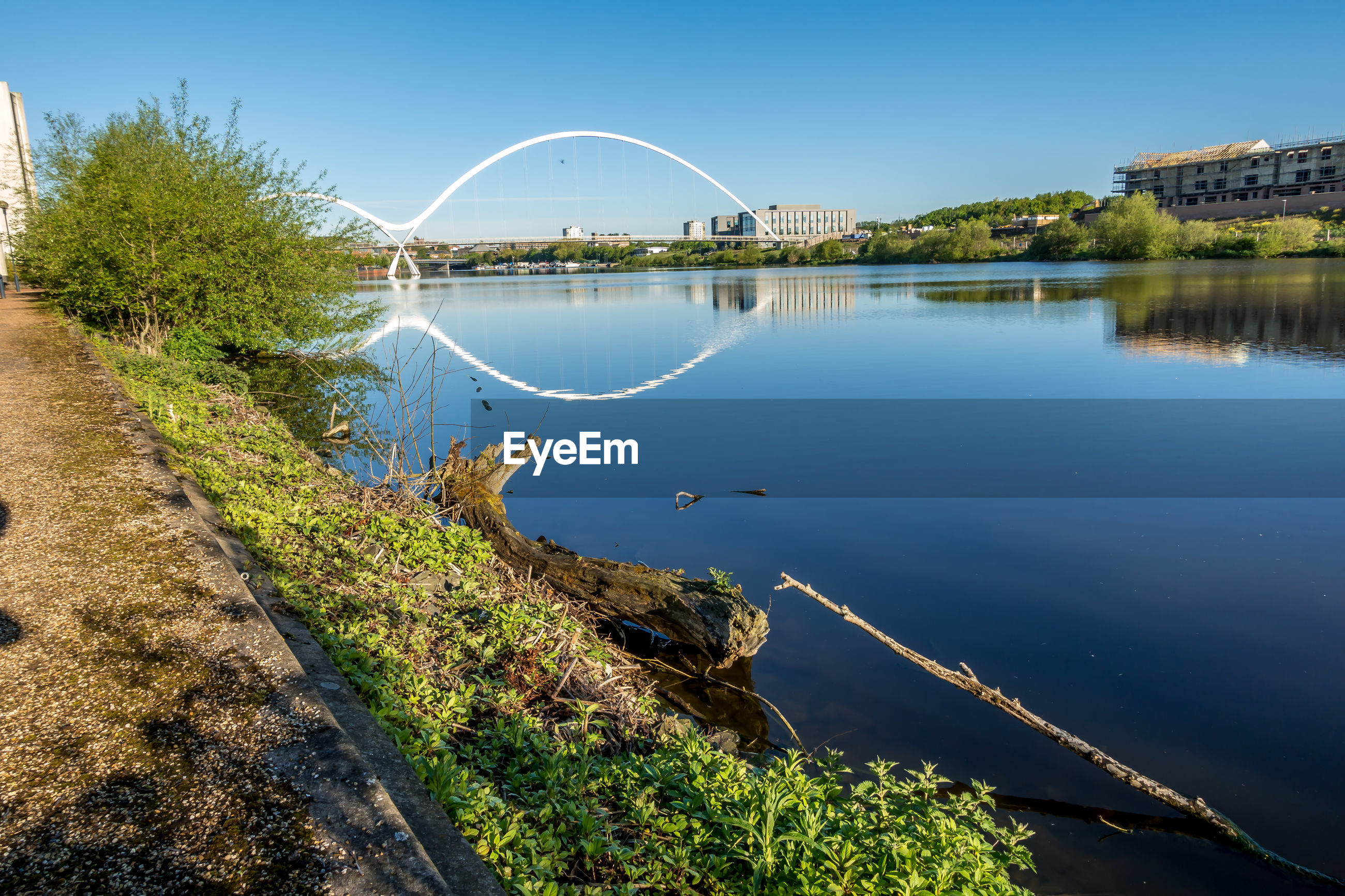 SCENIC VIEW OF LAKE AND BRIDGE AGAINST SKY