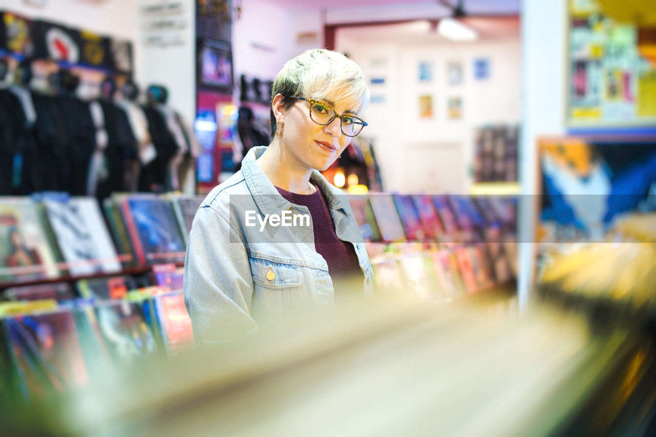 Portrait of woman standing in store