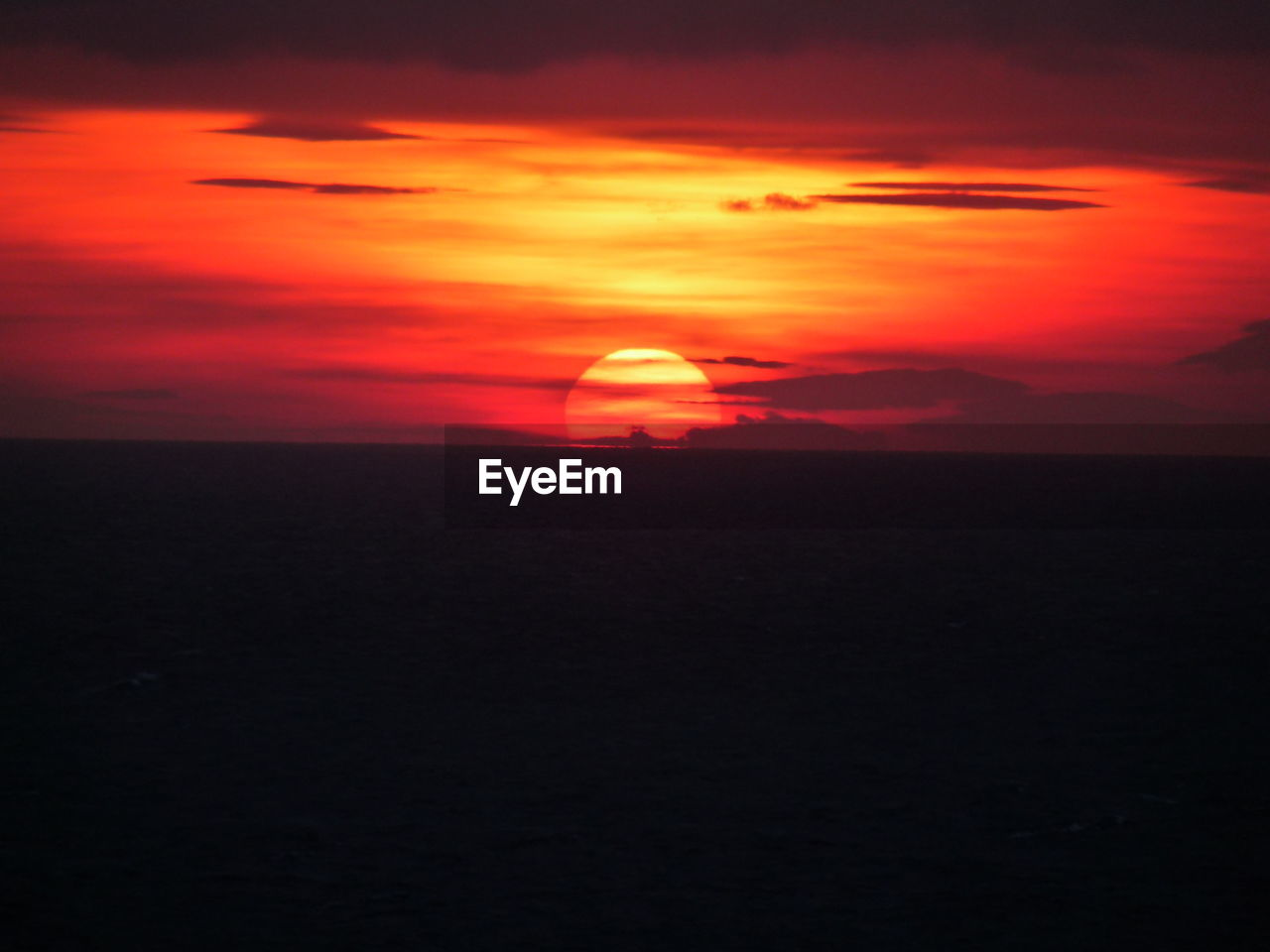 Idyllic shot of silhouette landscape against sunset sky