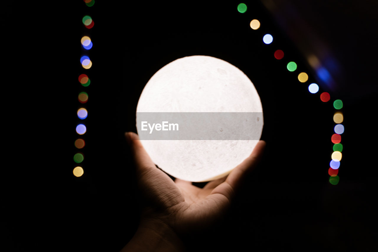 Close up holding moon in palm