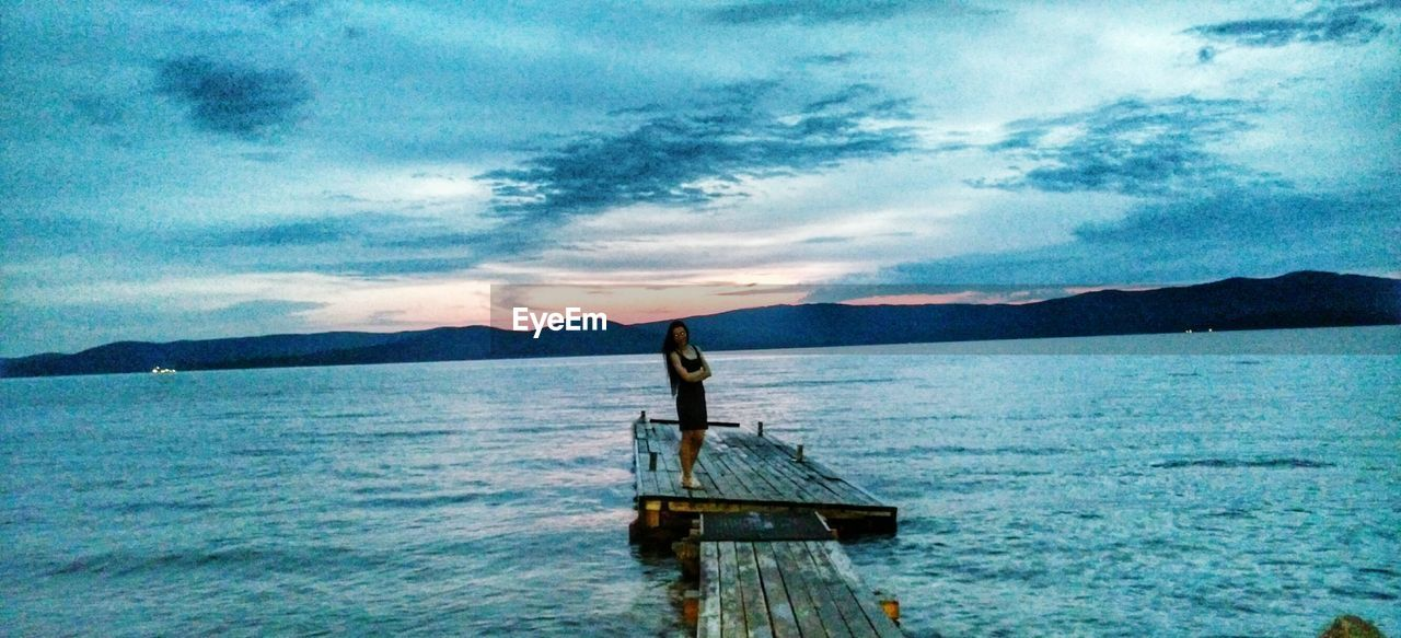 scenics, tranquility, water, sky, beauty in nature, mountain, nature, cloud - sky, sea, tranquil scene, no people, outdoors, day, sunset