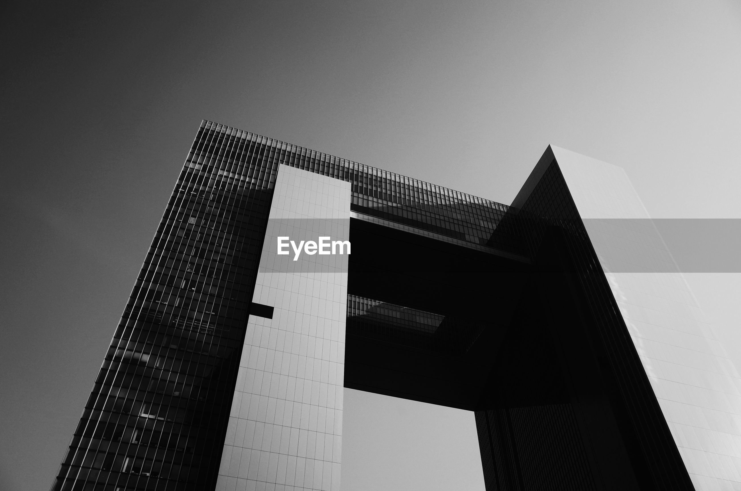 low angle view, architecture, built structure, building exterior, clear sky, tower, tall - high, building, sky, city, copy space, modern, no people, outdoors, skyscraper, day, tall, architectural feature, office building, high section
