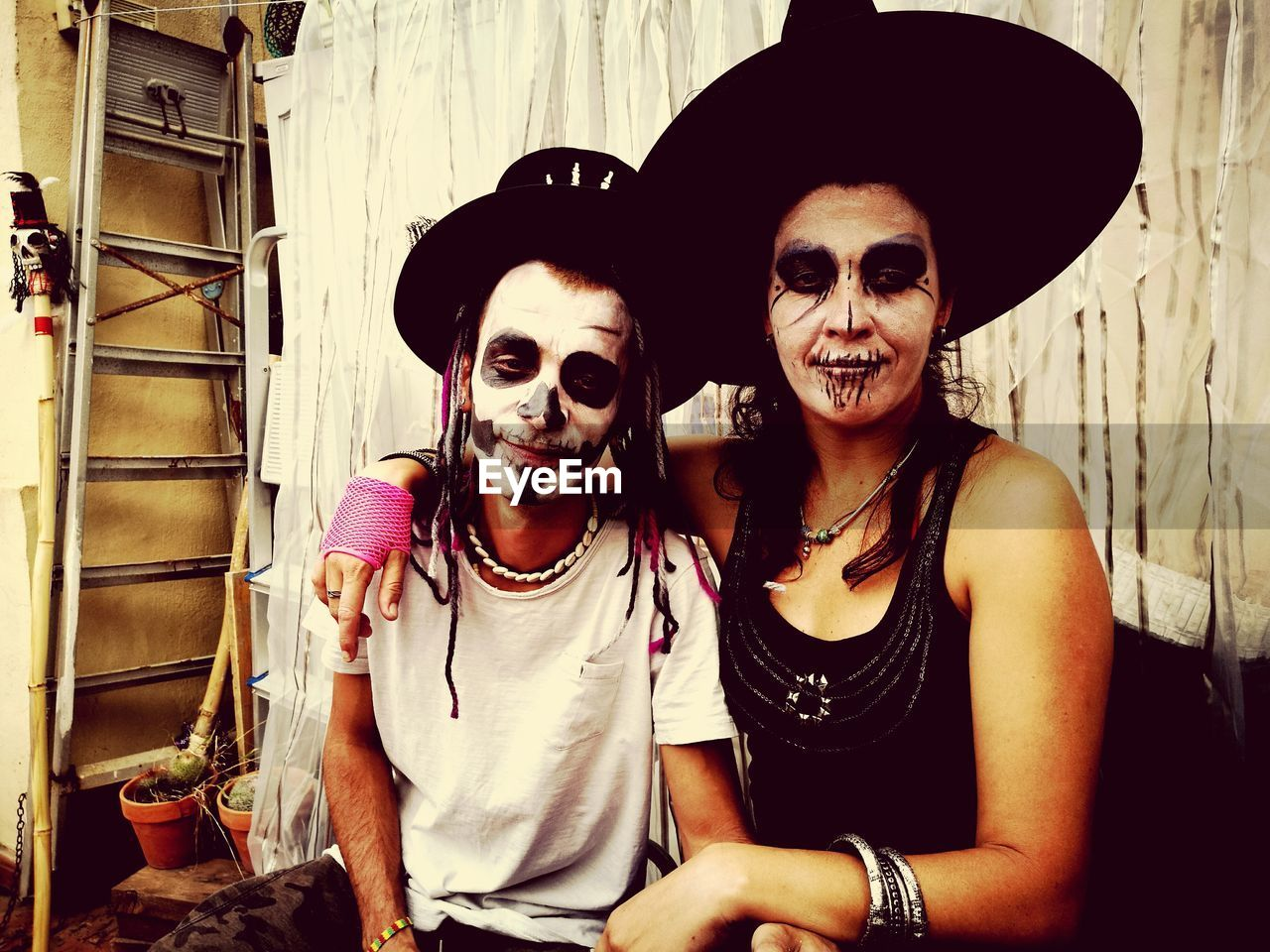 Portrait of happy mother and son with face paint during halloween