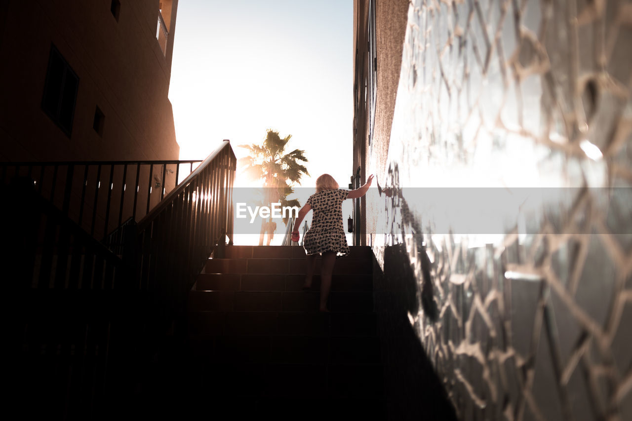 Low Angle View Of Woman Climbing Stairs