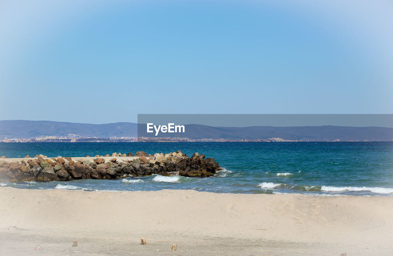 sea, water, sky, beauty in nature, scenics - nature, land, beach, tranquility, tranquil scene, copy space, nature, blue, sand, day, idyllic, clear sky, non-urban scene, no people, horizon, outdoors