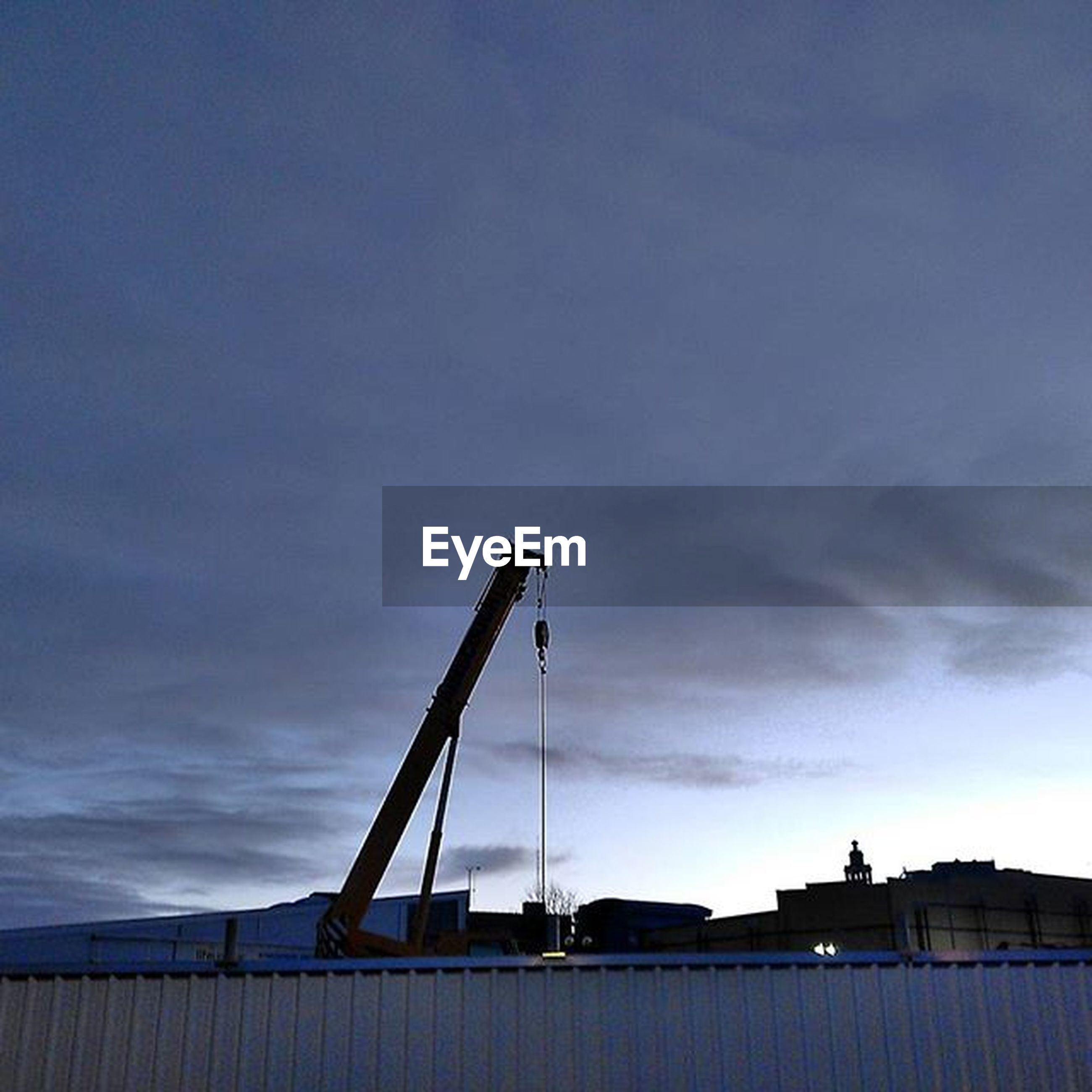 built structure, architecture, sky, building exterior, low angle view, industry, construction site, cloud - sky, crane - construction machinery, construction, development, crane, cloud, cloudy, factory, outdoors, smoke stack, no people, construction industry, incomplete