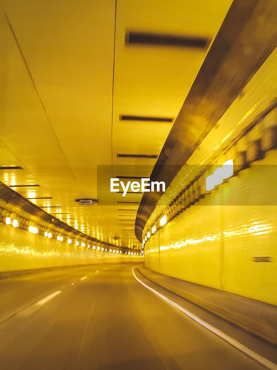 Interior Of Illuminated Yellow Tunnel
