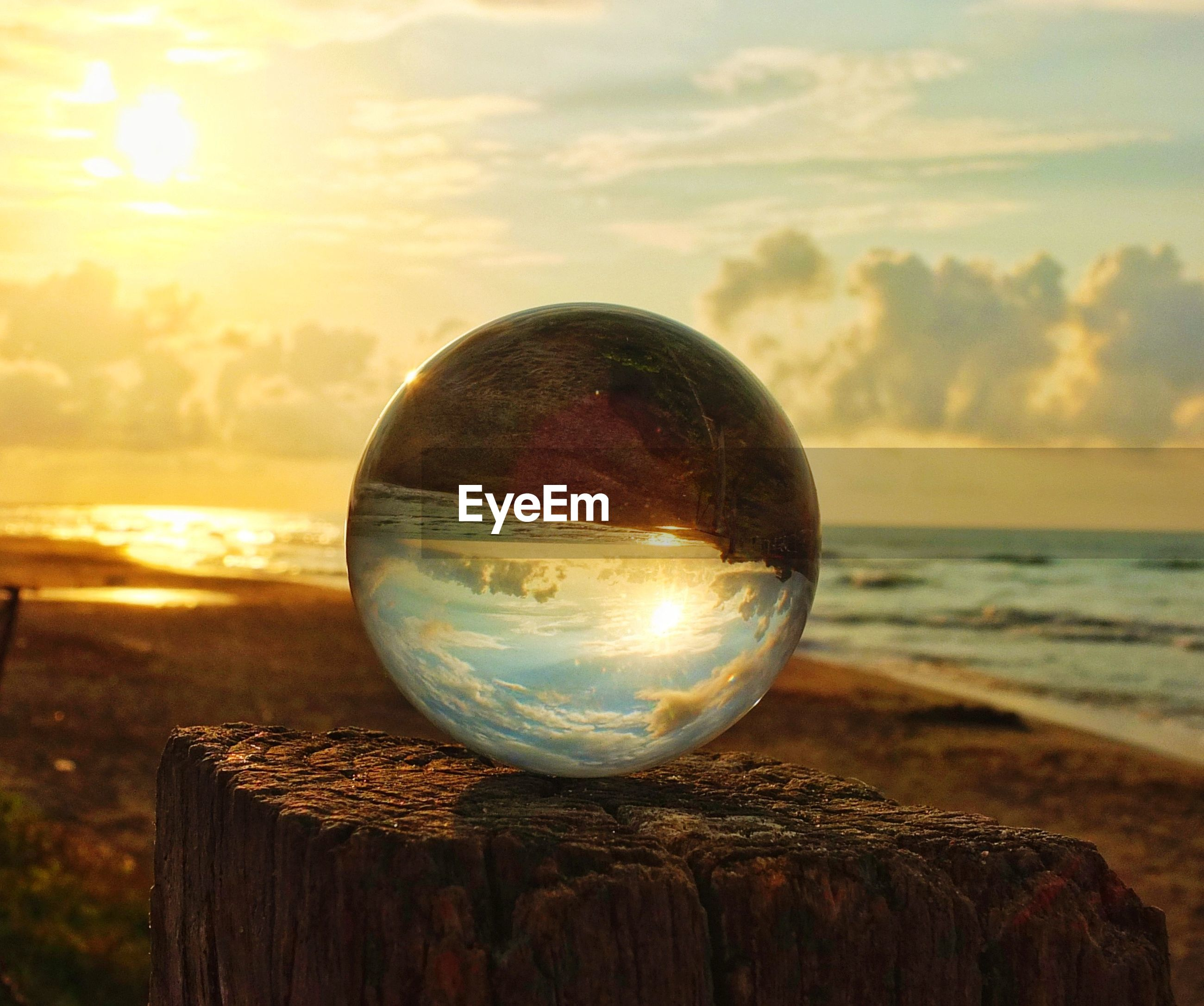 crystal ball, sphere, reflection, sea, sunset, horizon over water, sky, no people, beach, tranquility, nature, outdoors, crystal, close-up, scenics, tree, water, beauty in nature, day