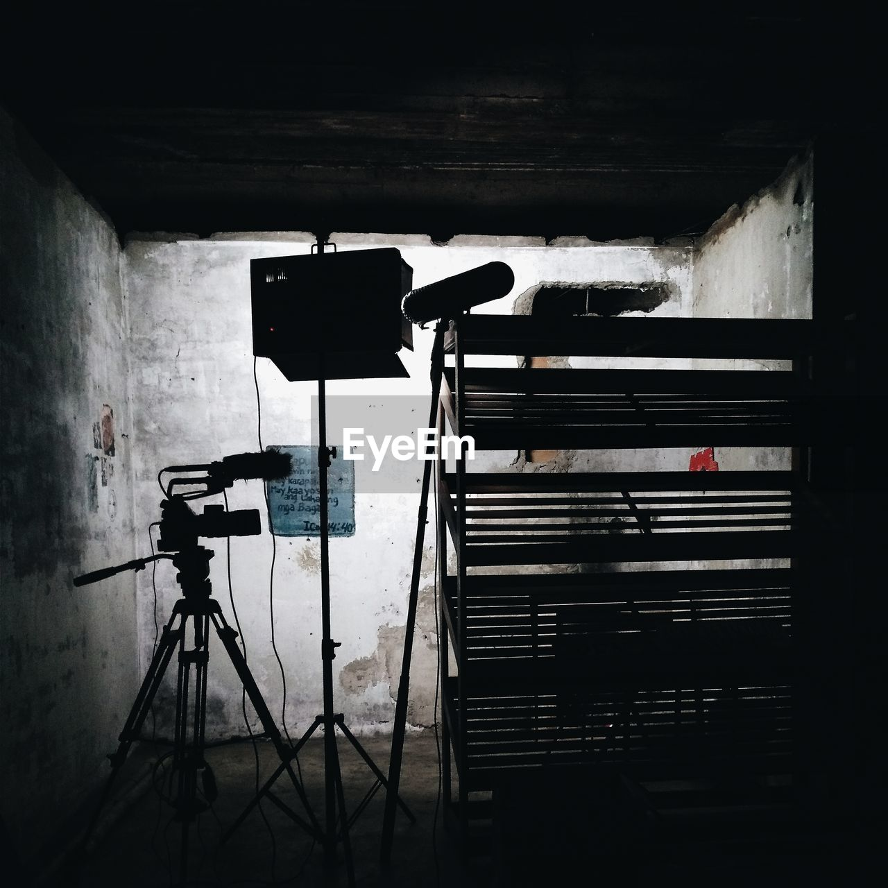 tripod, built structure, architecture, no people, indoors, photography themes, technology, wall - building feature, camera - photographic equipment, photographic equipment, communication, day, camera, staircase, building, silhouette, absence, arts culture and entertainment, railing, digital camera, filming