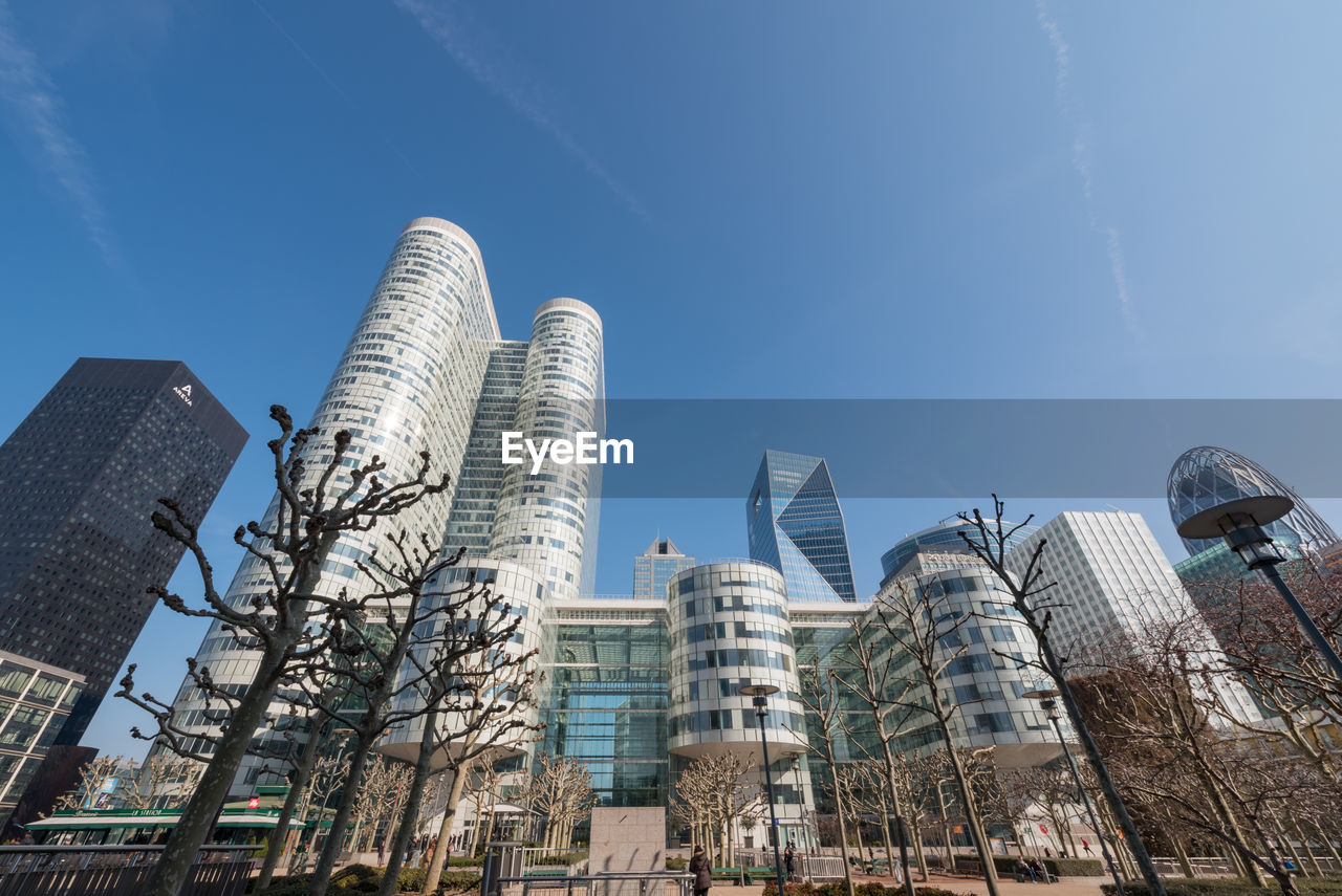 built structure, building exterior, architecture, sky, low angle view, city, office building exterior, building, skyscraper, tall - high, nature, day, tower, office, modern, no people, outdoors, sunlight, residential district, industry, financial district