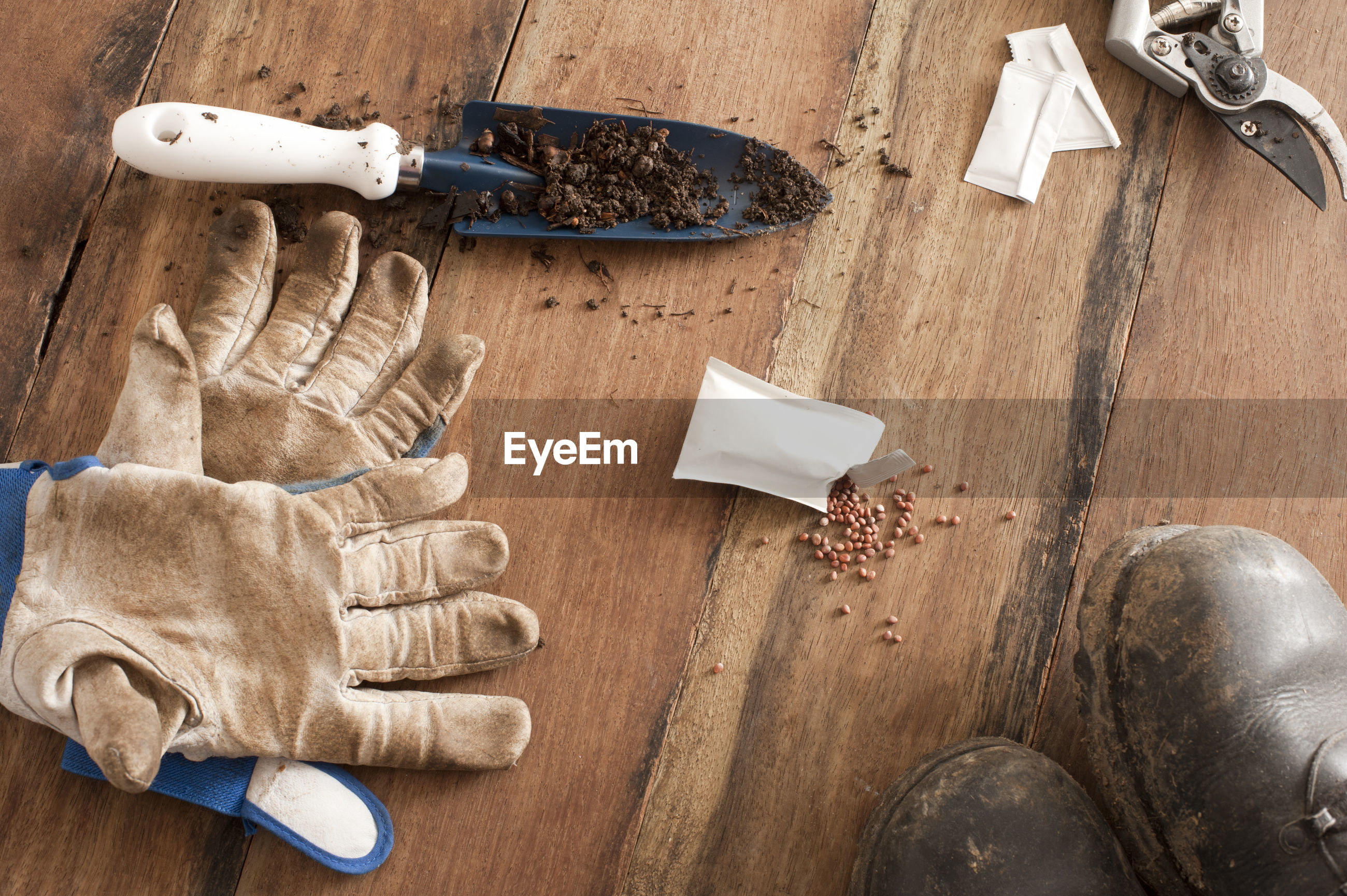 Directly above shot of gardening equipment with gloves and shoes