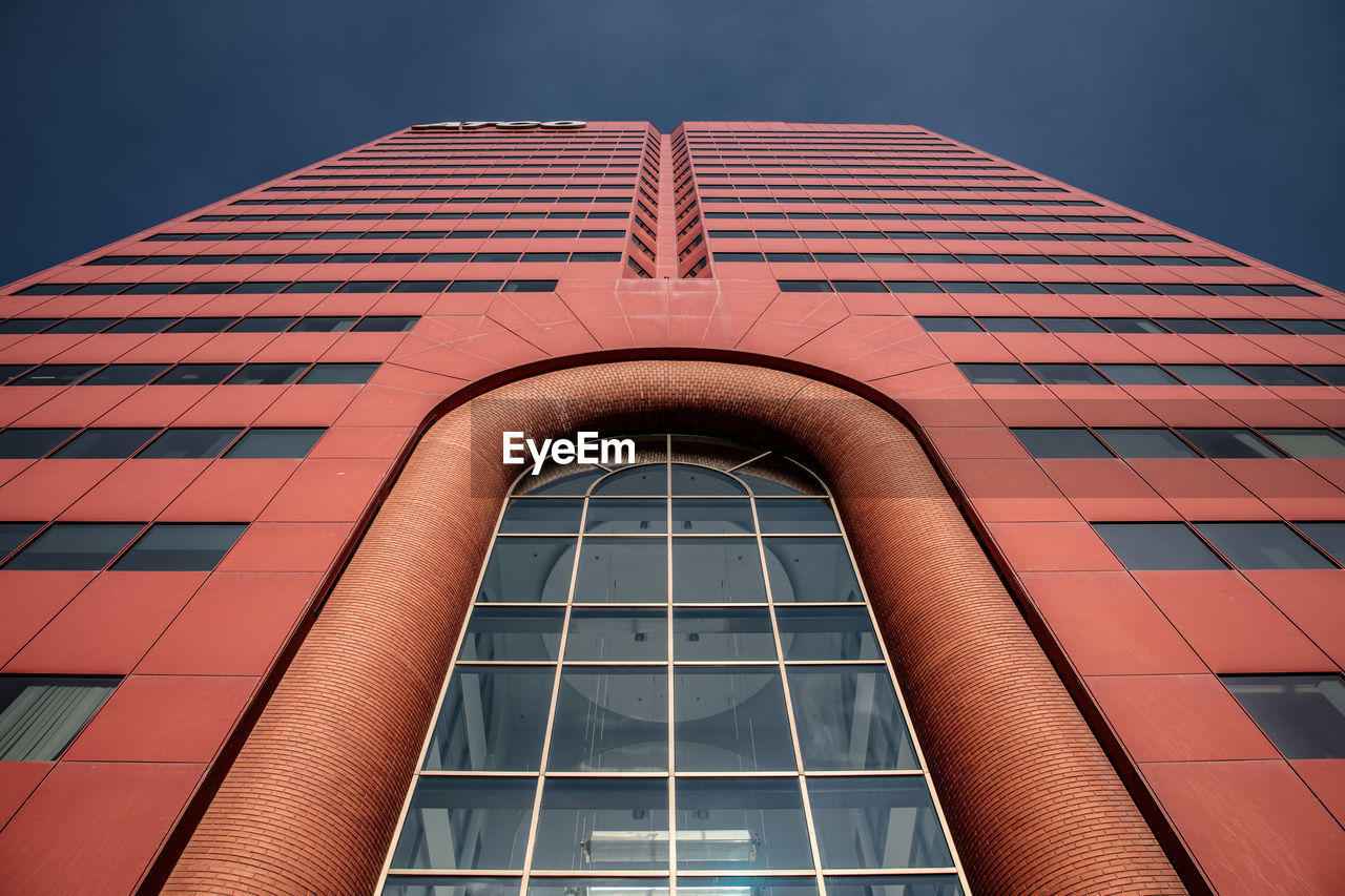 architecture, built structure, building exterior, low angle view, building, window, no people, red, sky, pattern, office building exterior, city, modern, day, nature, office, outdoors, clear sky, geometric shape, glass - material, skyscraper, window frame