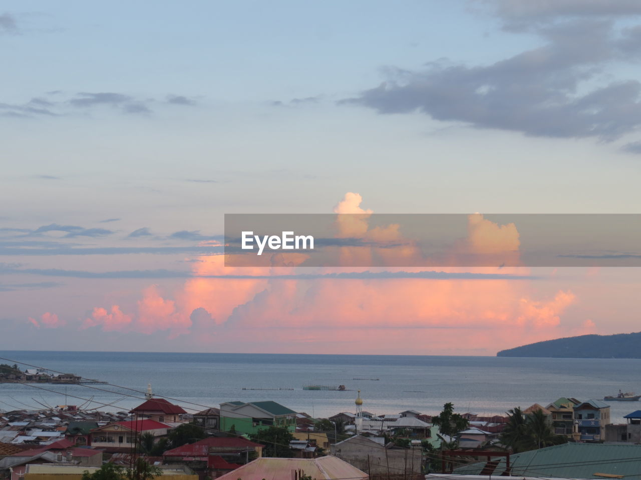 sky, sea, horizon over water, cloud - sky, water, sunset, built structure, beauty in nature, scenics, nature, no people, building exterior, architecture, outdoors, day, cityscape, city