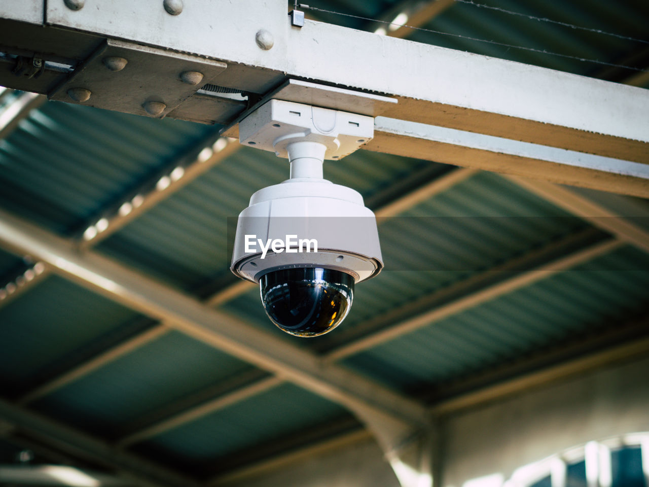 Low Angle View Of Security Camera Hanging From Ceiling In Train Station, Berlin