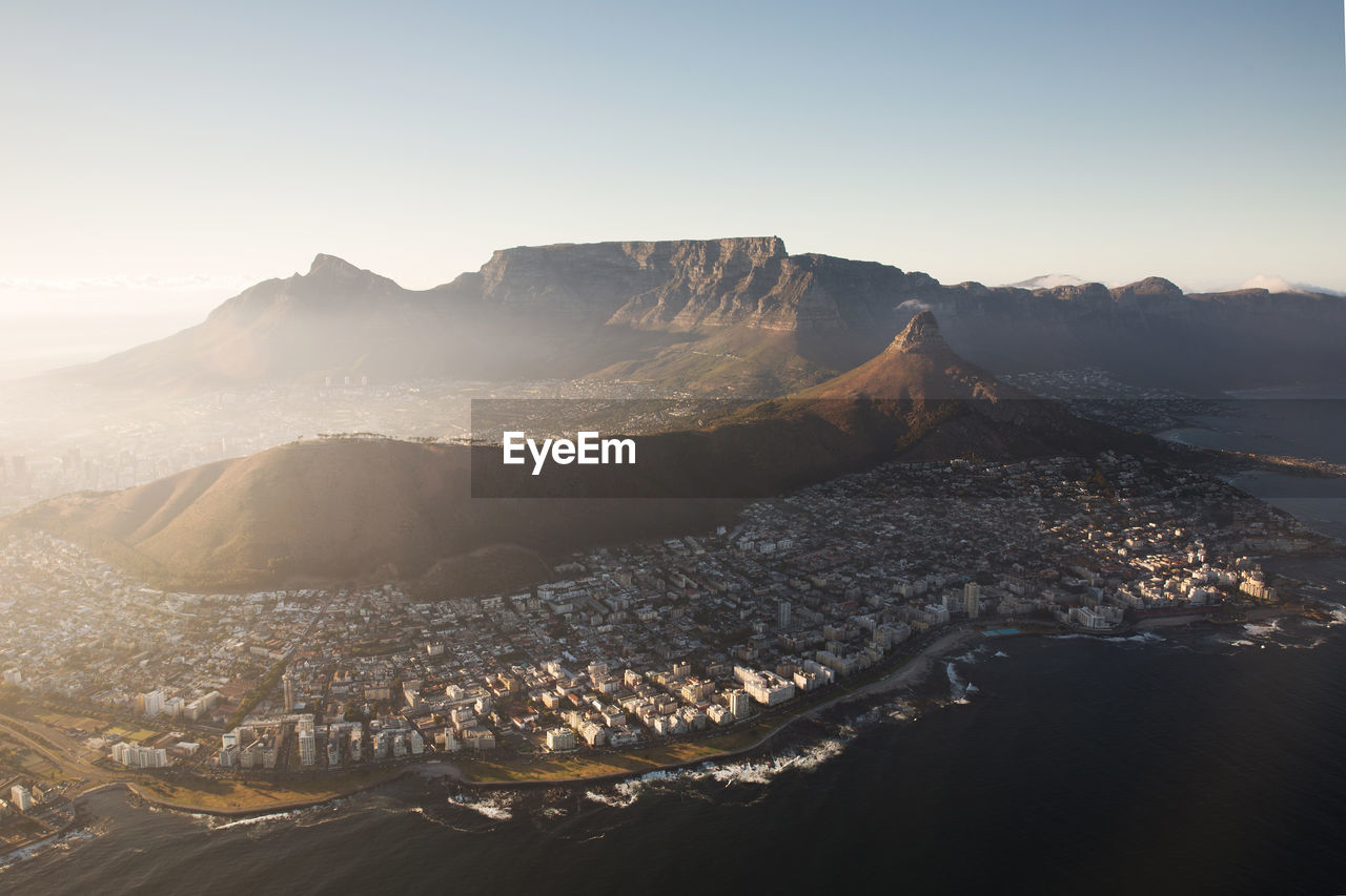 High Angle Shot Of Town Against Mountains