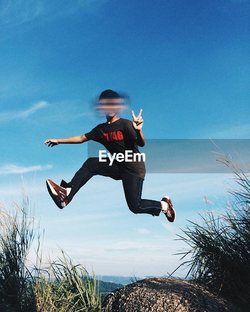 mid-air, jumping, one person, full length, day, outdoors, sky, blue, energetic, one man only, nature, only men, young adult, people, adult, adults only