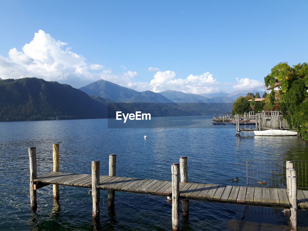 water, mountain, sky, nautical vessel, scenics - nature, beauty in nature, nature, tranquil scene, transportation, tranquility, no people, lake, cloud - sky, mode of transportation, day, idyllic, mountain range, outdoors, wooden post, bay