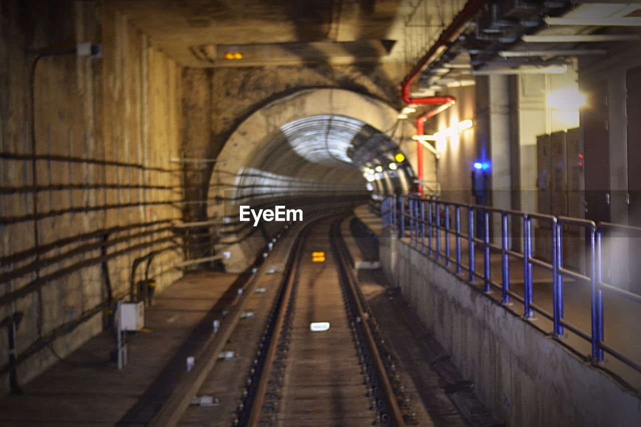 architecture, rail transportation, built structure, transportation, illuminated, railroad track, direction, track, arch, the way forward, lighting equipment, connection, public transportation, mode of transportation, no people, bridge, railing, bridge - man made structure, tunnel, indoors, architectural column, ceiling, subway train, long