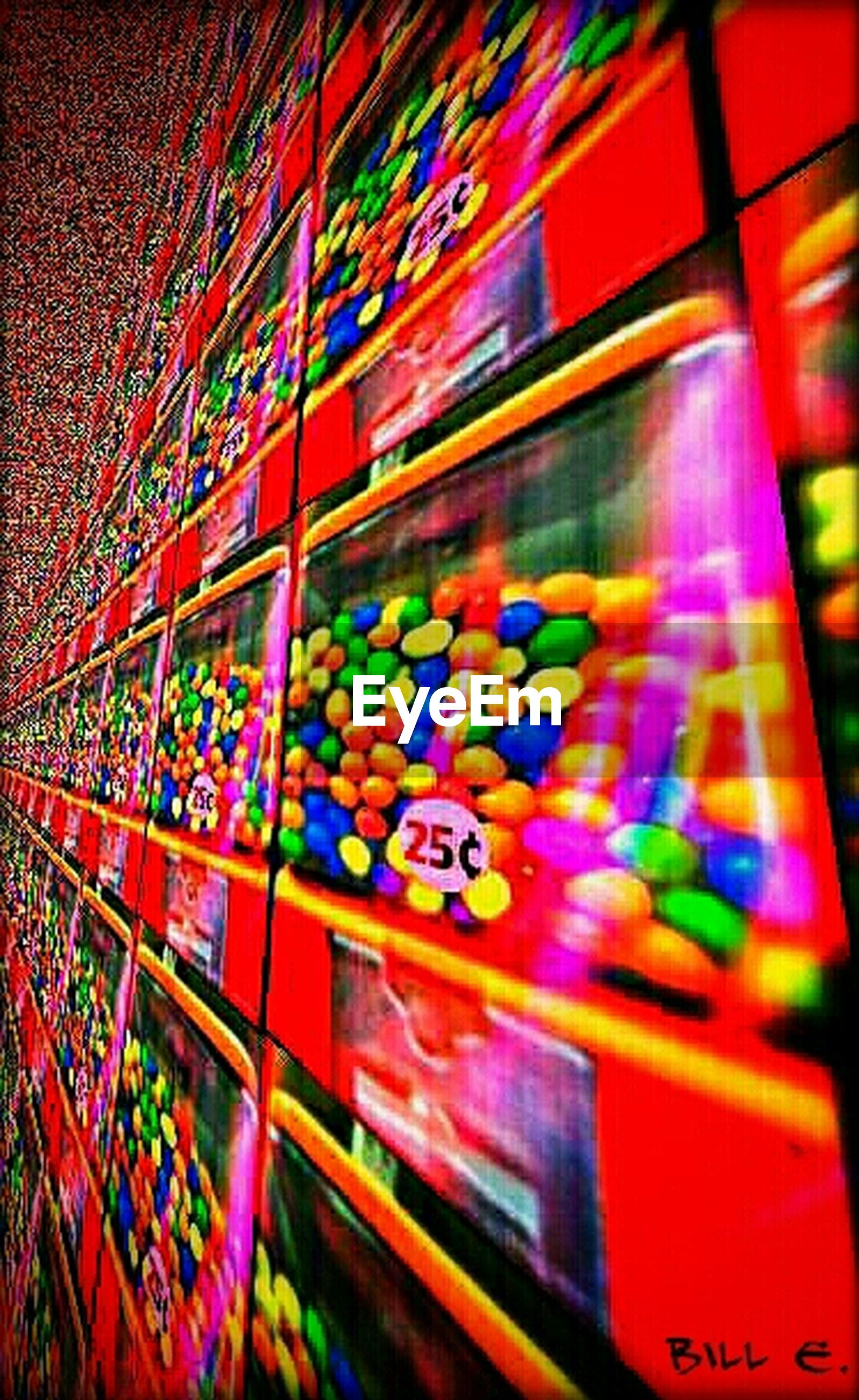 multi colored, indoors, illuminated, colorful, text, night, variation, low angle view, art, western script, creativity, communication, pattern, no people, art and craft, architecture, lighting equipment, choice, built structure, store