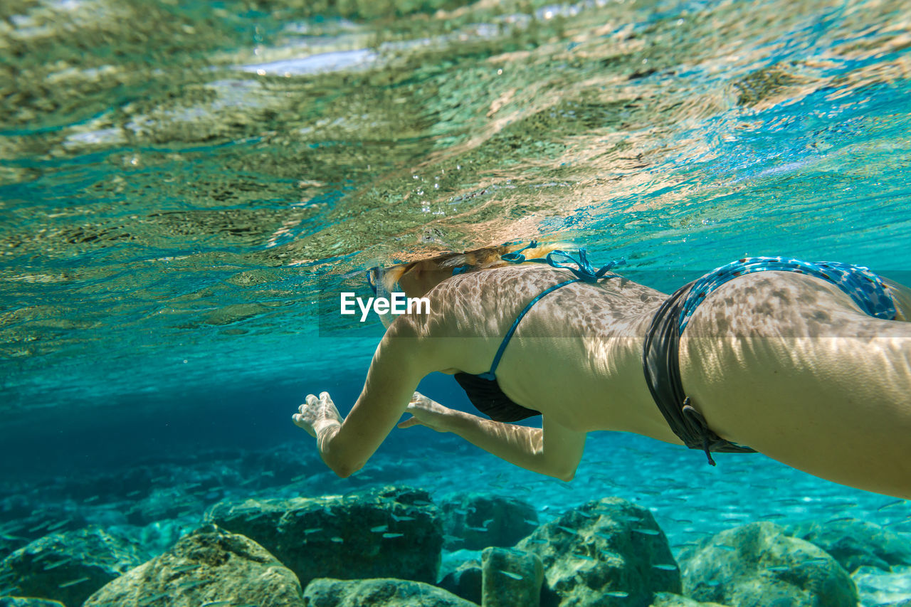 Close-up of mature woman swimming undersea