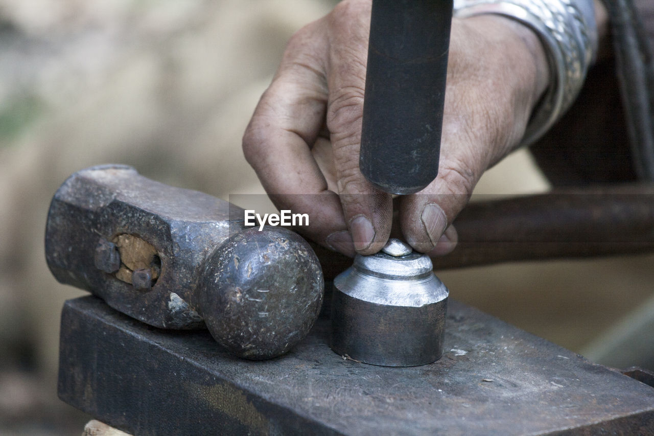 Cropped Hand Of Blacksmith Working In Workshop