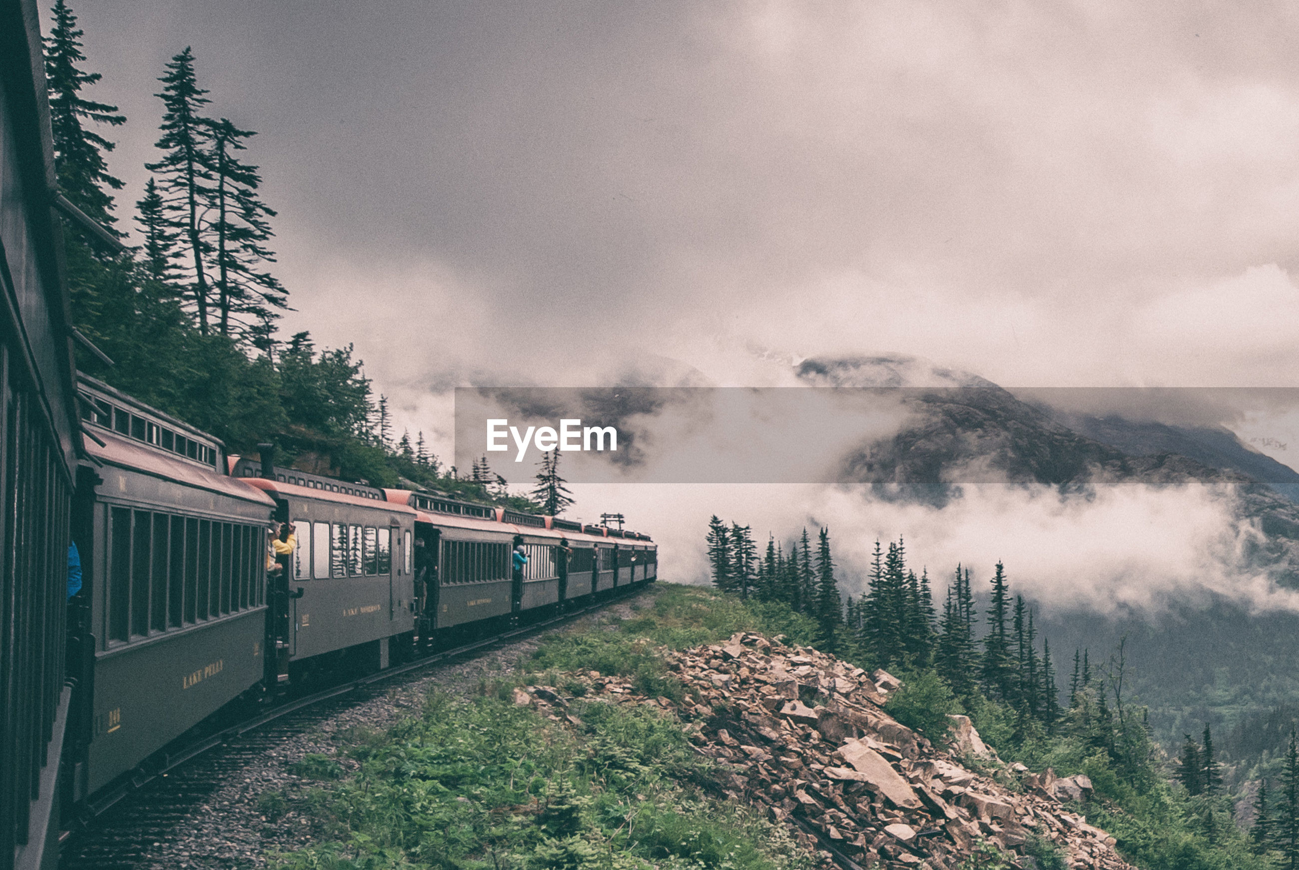 Train by mountain during foggy weather