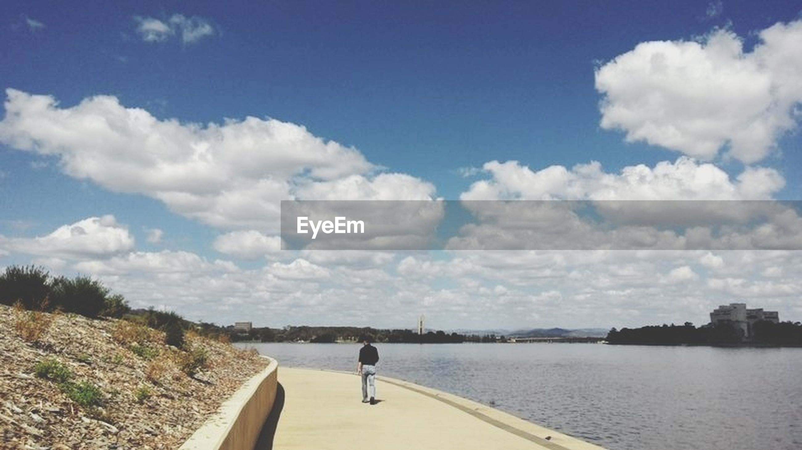 sky, water, cloud - sky, cloud, transportation, rear view, nature, river, sea, tranquility, tranquil scene, cloudy, day, the way forward, scenics, lifestyles, lake, beauty in nature