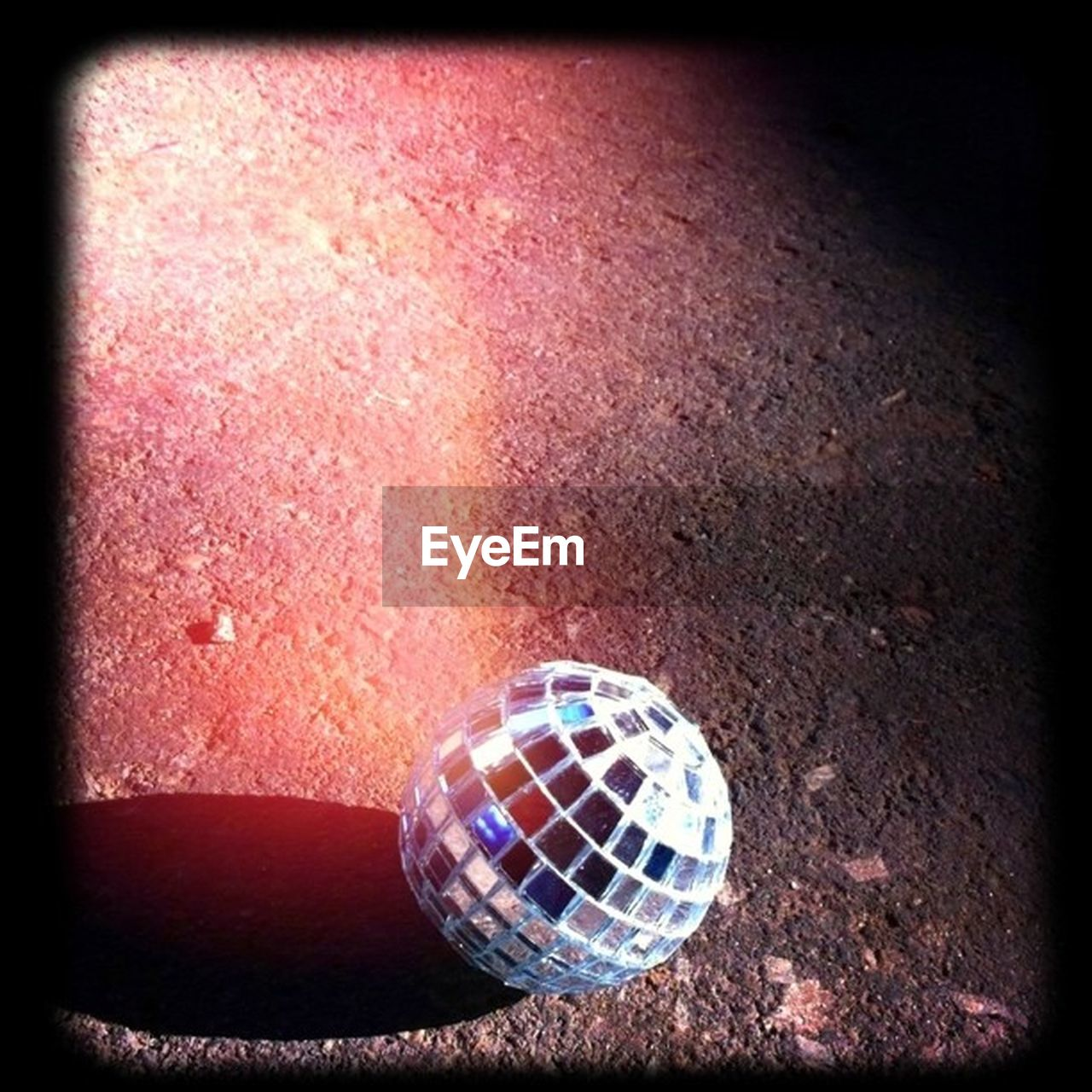 ball, no people, vignette, close-up, night, indoors