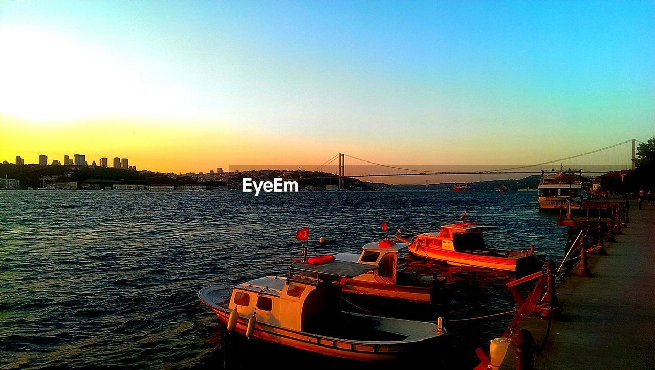 nautical vessel, sunset, sea, water, architecture, transportation, built structure, no people, clear sky, mode of transport, building exterior, moored, sky, nature, outdoors, city, cityscape, harbor, scenics, skyscraper, beauty in nature, day