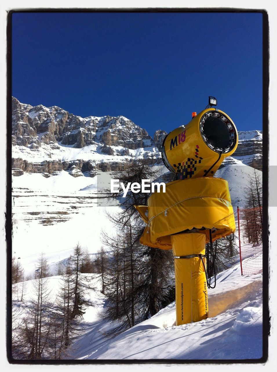 snow, cold temperature, winter, weather, nature, mountain, clear sky, day, yellow, outdoors, beauty in nature, blue, frozen, tranquility, scenics, no people, low angle view, tree, sky, ski lift