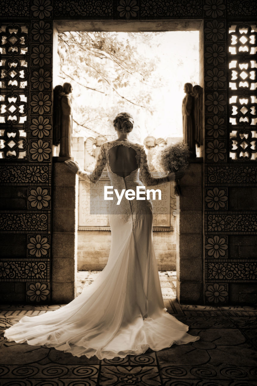Rear View Of Bride Standing In Doorway