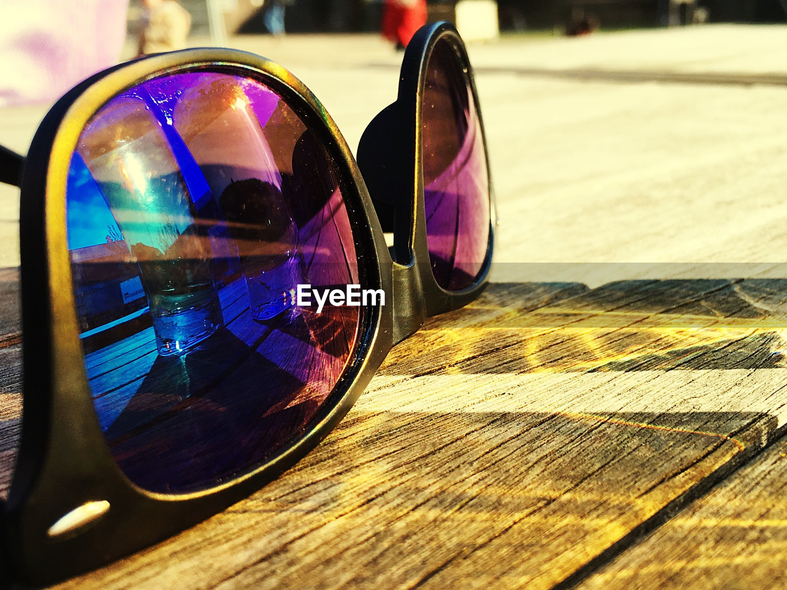 Close-up of sunglasses on wooden table