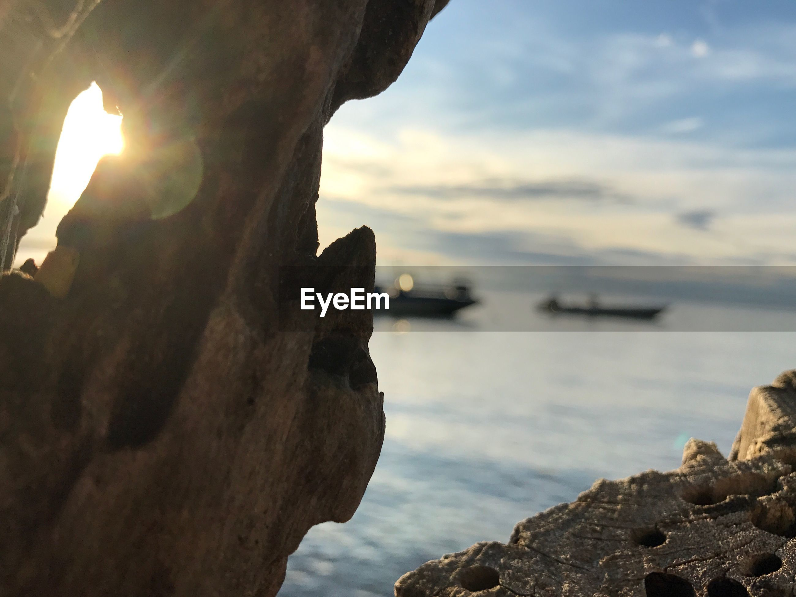 SCENIC VIEW OF ROCKS AT SEA AGAINST SKY