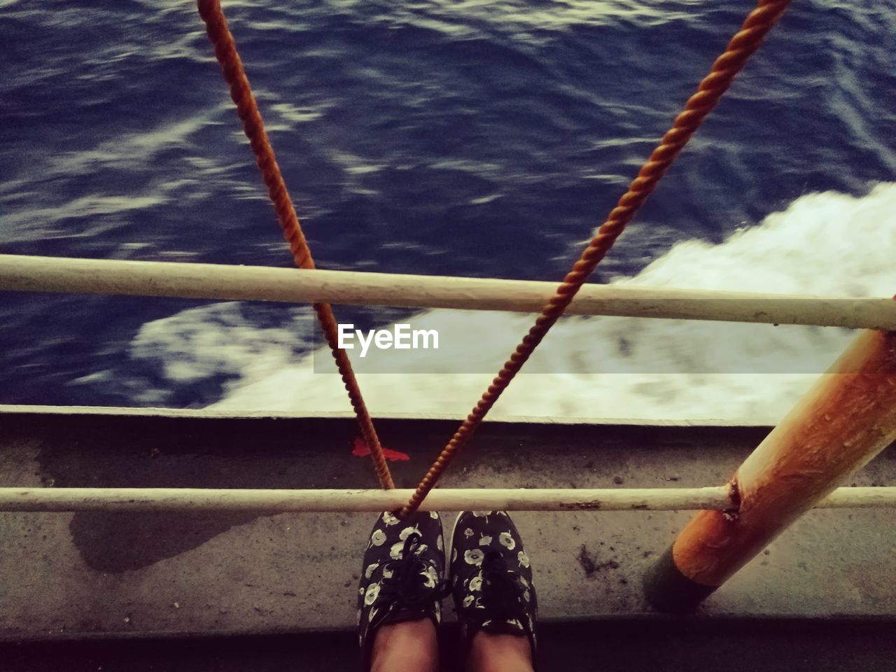 low section, sea, human leg, water, rope, one person, human body part, day, real people, outdoors, close-up, nautical vessel, people