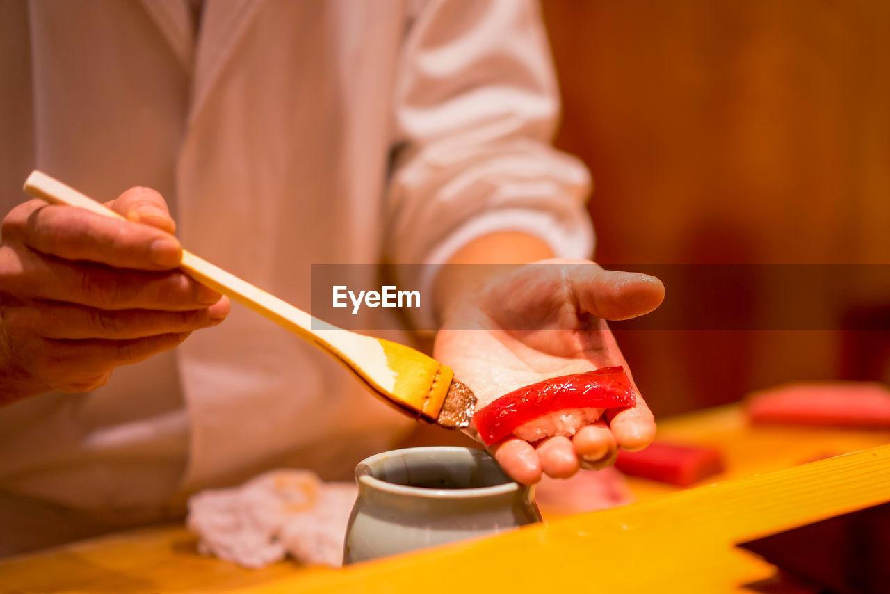 CLOSE-UP OF Chef Preparing Sushi