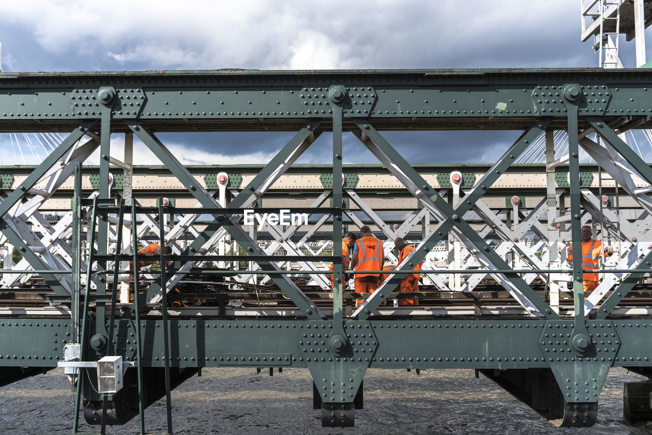 built structure, metal, day, architecture, sky, bridge - man made structure, outdoors, cloud - sky, transportation, machinery, industry, no people, girder