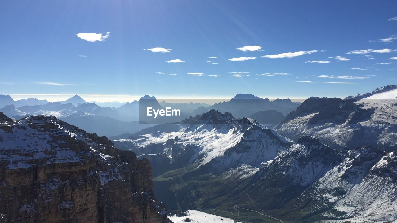 mountain, beauty in nature, mountain range, sky, scenics - nature, snow, tranquil scene, winter, cold temperature, tranquility, cloud - sky, environment, nature, day, non-urban scene, idyllic, no people, architecture, landscape, snowcapped mountain, outdoors, mountain peak, formation