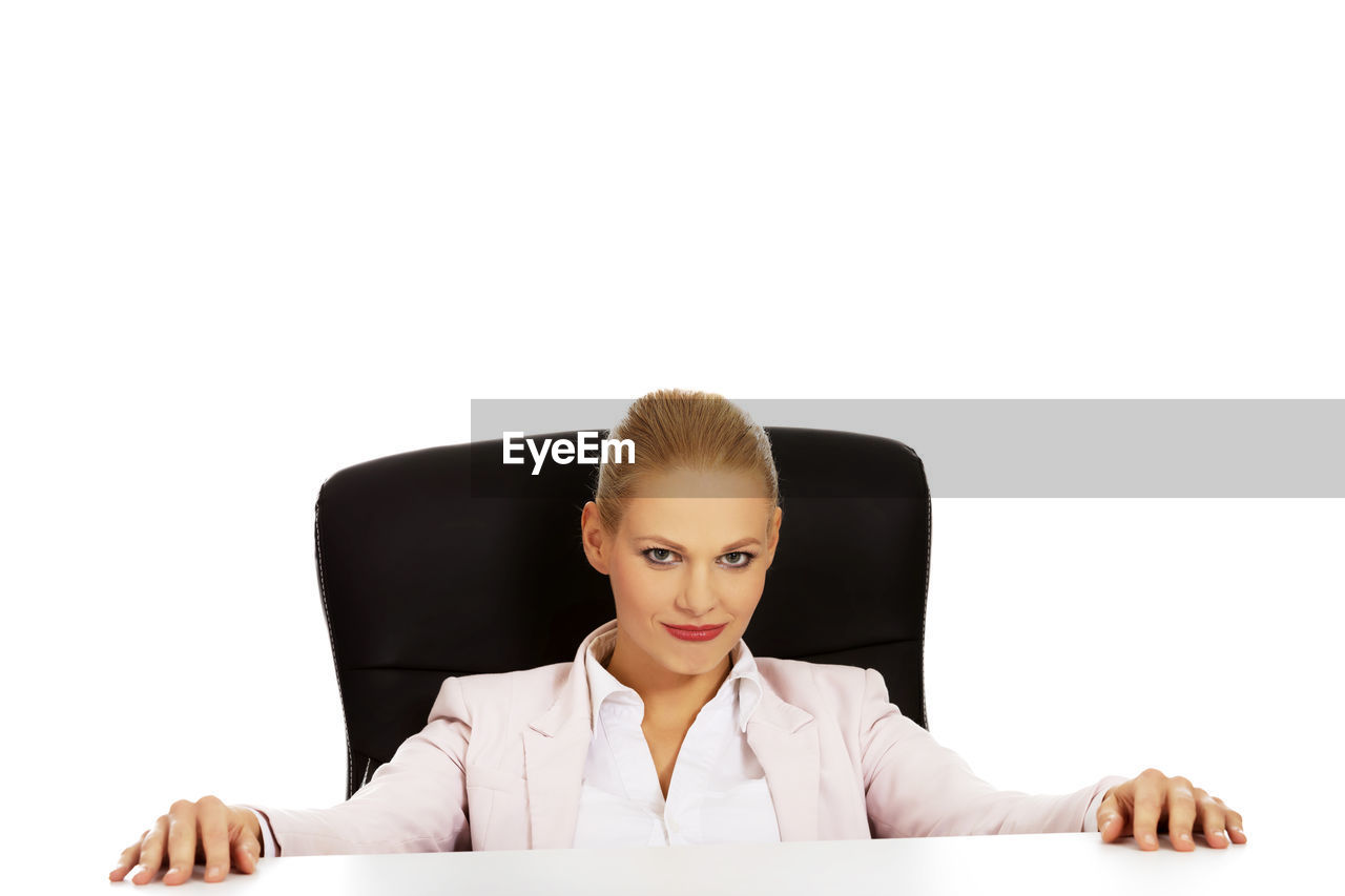 Confident businesswoman against white background