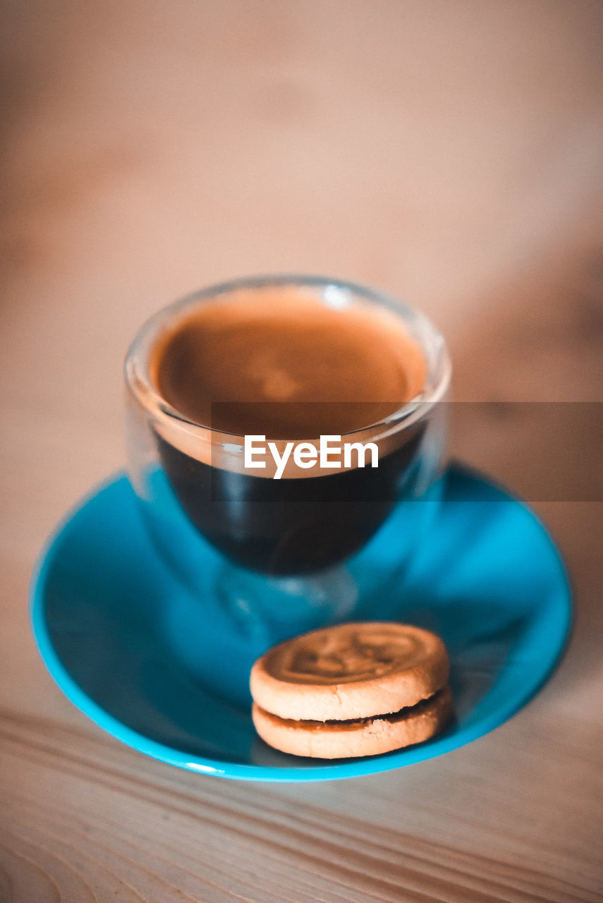 table, food and drink, cup, refreshment, drink, mug, still life, indoors, close-up, coffee - drink, wood - material, coffee cup, freshness, coffee, focus on foreground, saucer, no people, crockery, selective focus, hot drink, tea cup, temptation, non-alcoholic beverage