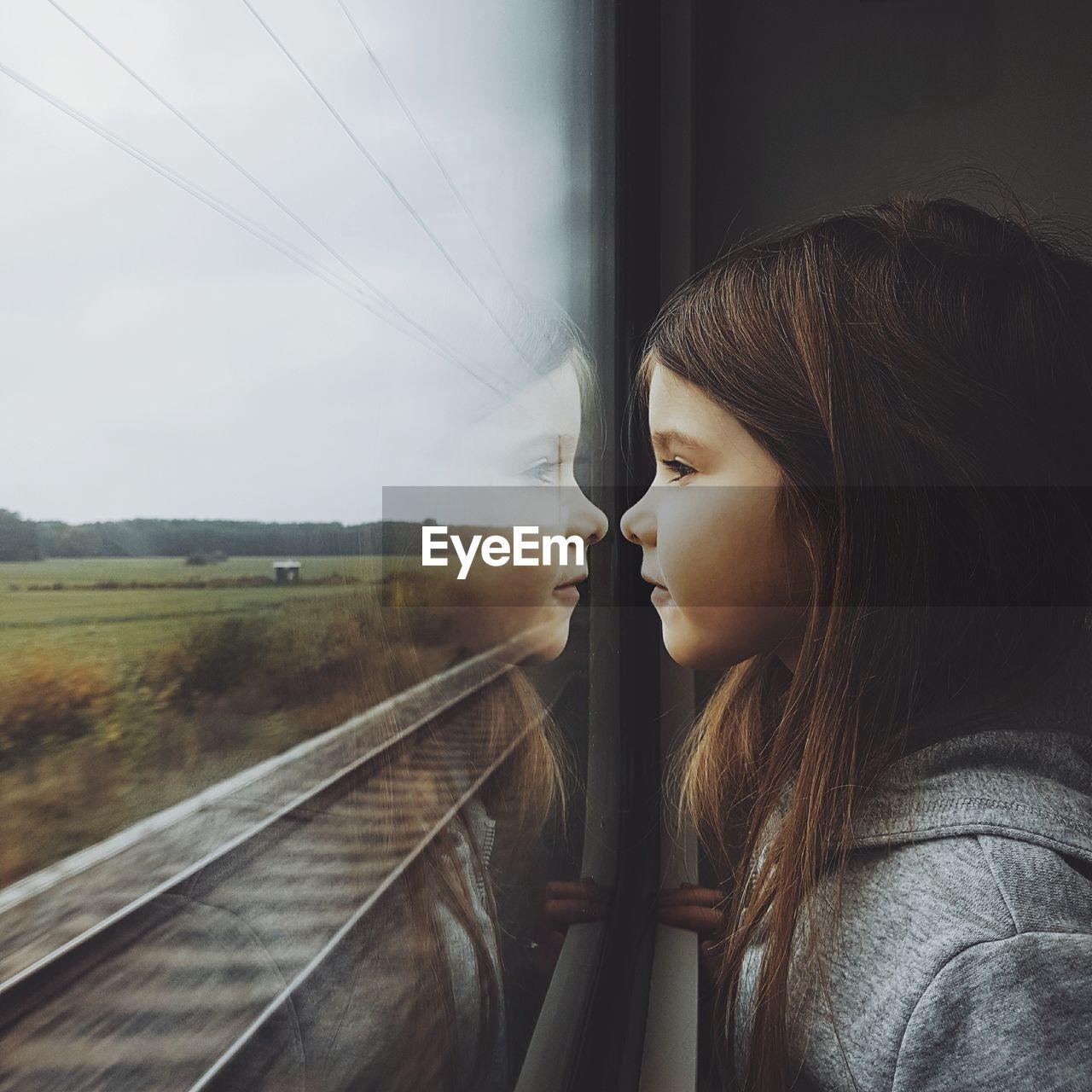 Cute girl in train