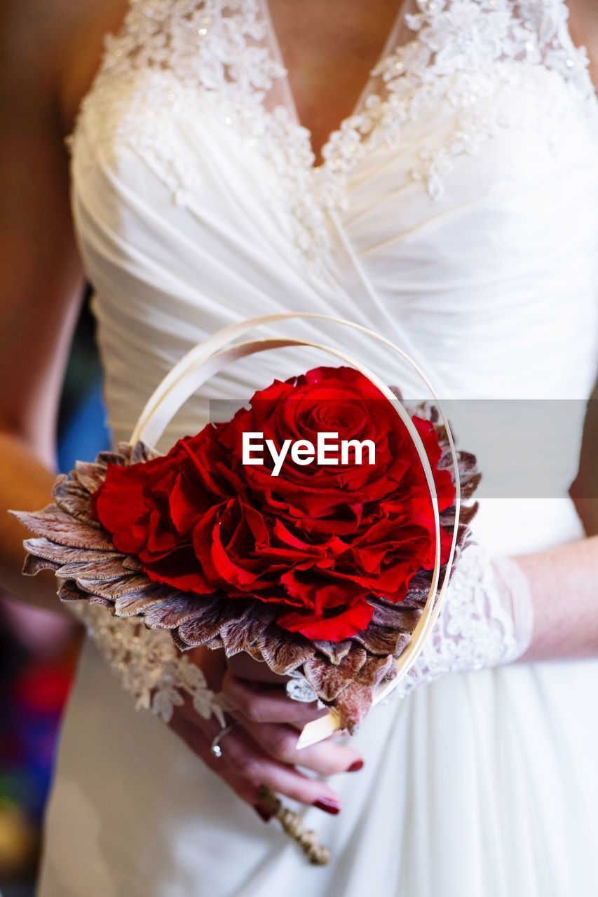 red, midsection, women, one person, holding, real people, flower, adult, wedding, newlywed, bride, flowering plant, event, rose, white color, celebration, clothing, wedding dress, rose - flower, hand, bouquet, flower arrangement, wedding ceremony