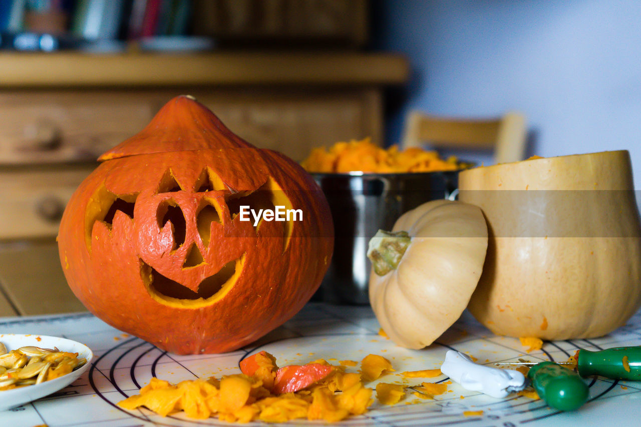 Carved pumpkin on table