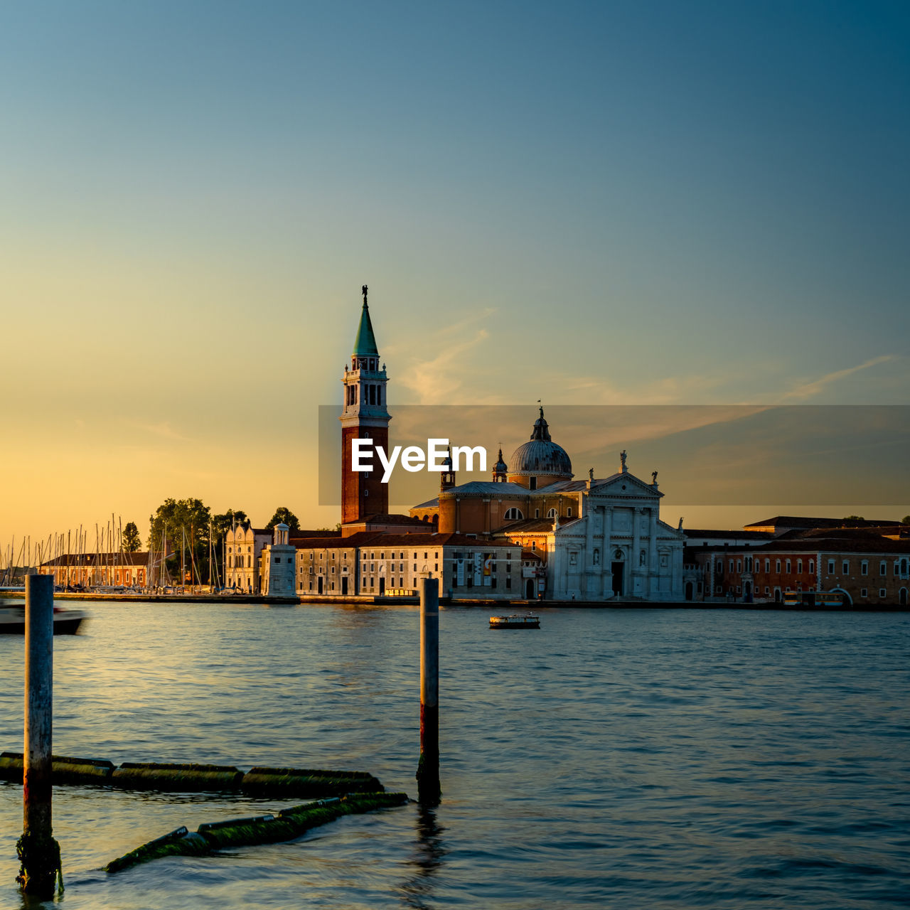 City of venice at sunset with basilica across canal