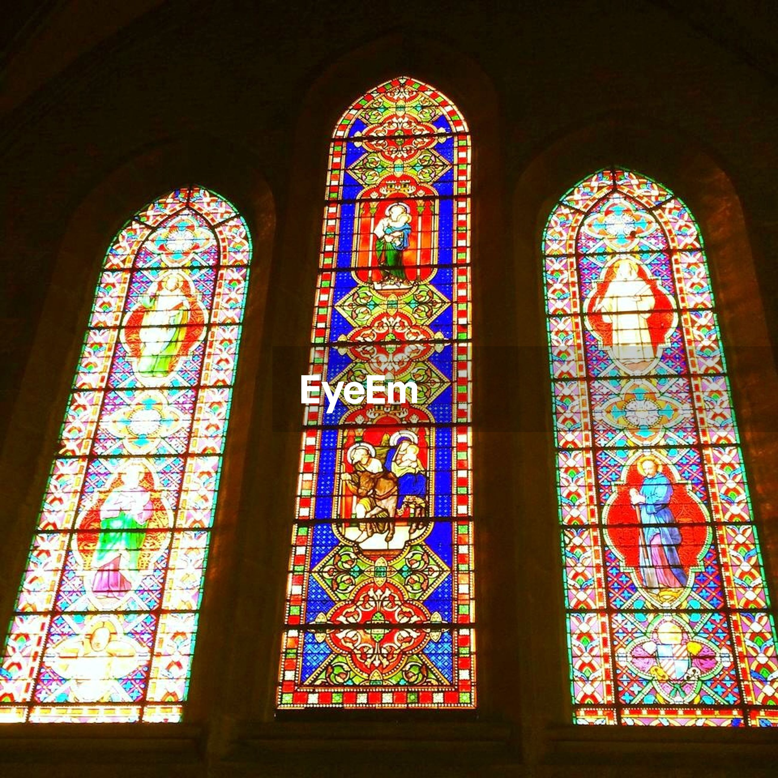 religion, indoors, place of worship, spirituality, church, stained glass, cathedral, window, architecture, arch, built structure, multi colored, ornate, design, human representation, art, art and craft, pattern