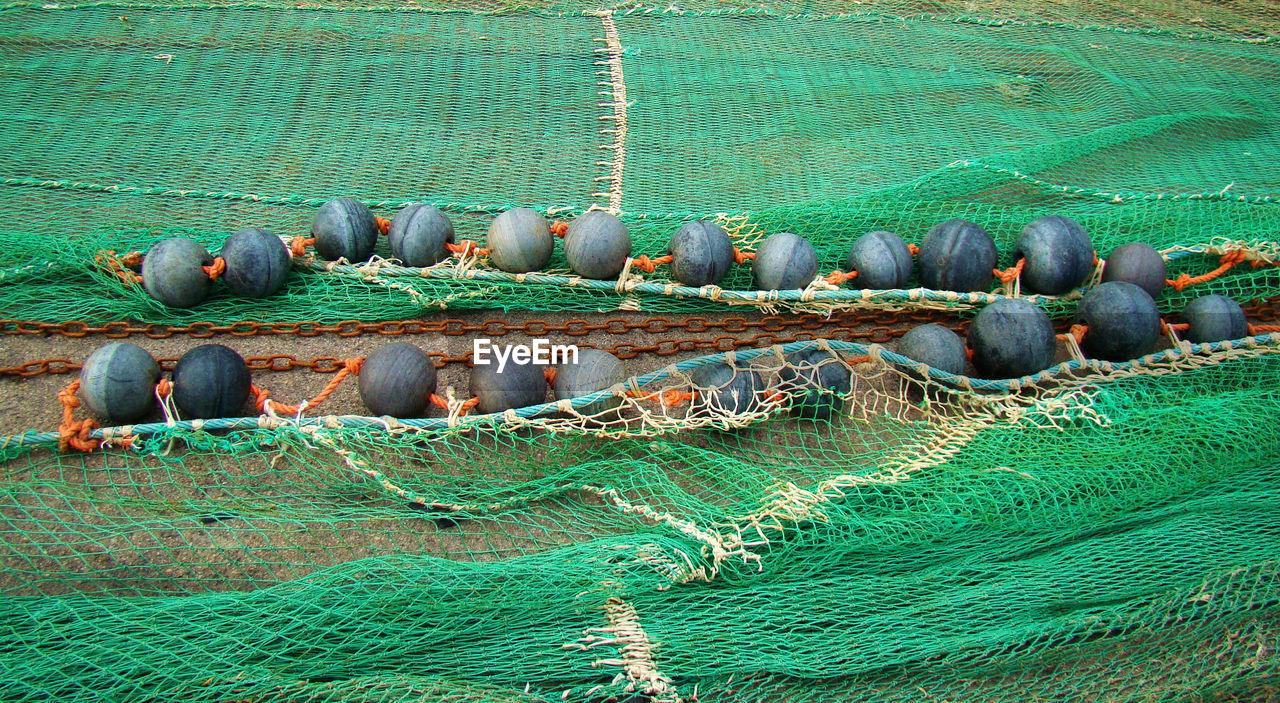 water, day, no people, sea, nature, fishing net, high angle view, buoy, land, waterfront, outdoors, fishing, beauty in nature, nautical vessel, fishing industry, rope, transportation, turquoise colored, green color