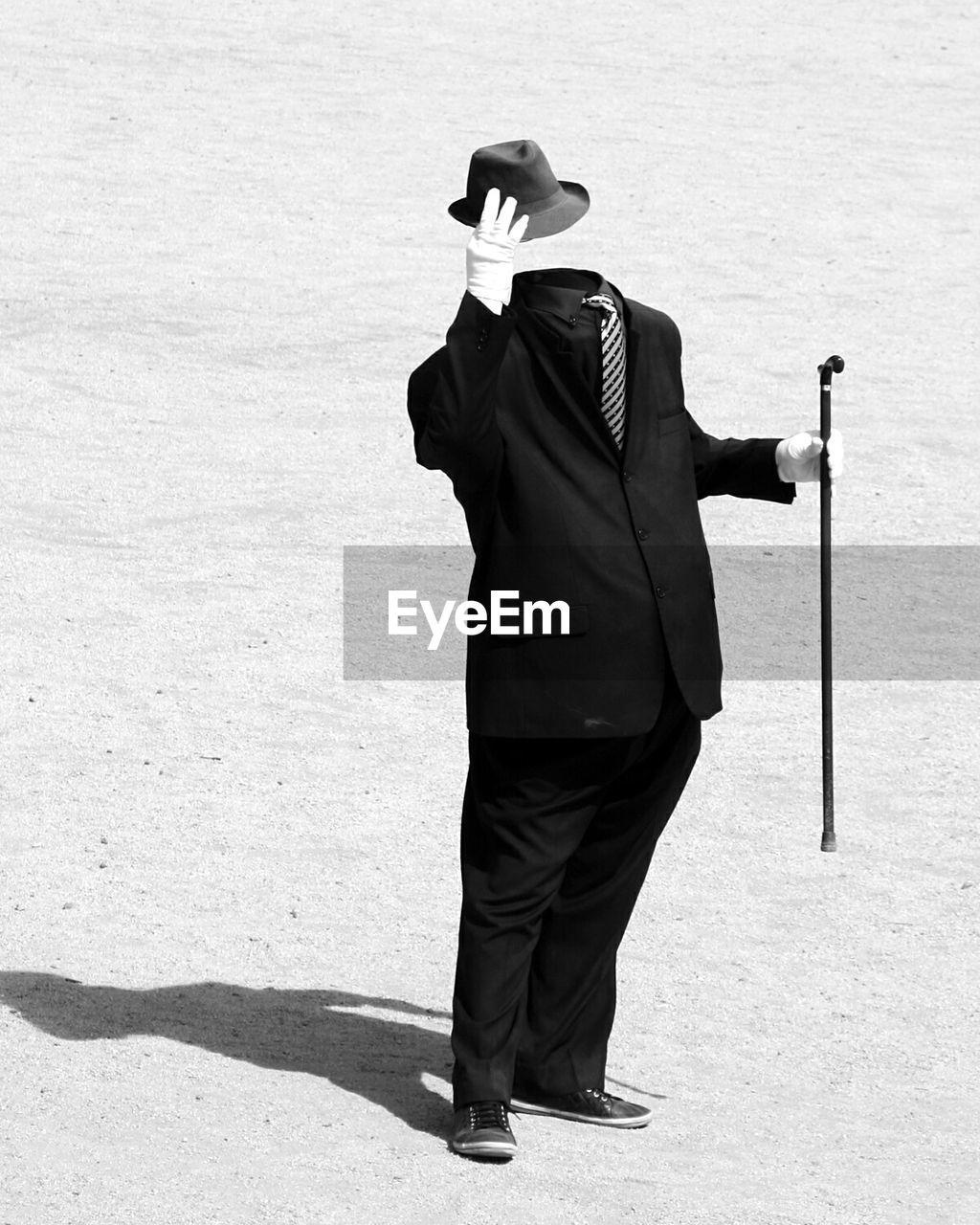 Invisible man lifting hat