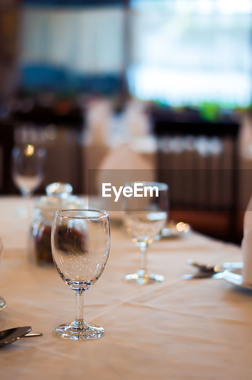 table, food and drink, refreshment, glass, drink, alcohol, wineglass, wine, indoors, focus on foreground, drinking glass, transparent, still life, freshness, glass - material, no people, close-up, household equipment, restaurant, business, red wine, luxury